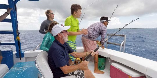 Family having fun on a deep sea fishing trip in Cozumel